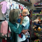 Nancy & grandson, Ryder, check out the kids section.